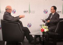 Mr Paul Budde, Indepedent Telecommunications Analyst, BuddeComm being interviewed by Maximillian Jacobson - Gonzalez, ITU in the ITU TV Studio WCIT 2012, Dubai, UAE. December 2012.